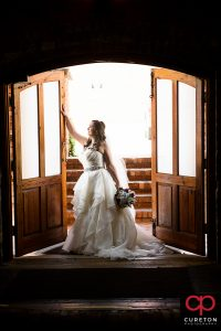 Bride holding onto the door during her Old Cigar Warehouse bridal session..