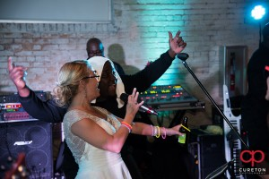 Bride singing with teh bacnd.