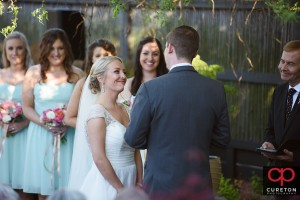 Bride smiling at her groom during thier outtd