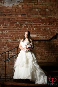 Bride on the staircase at Old Cigar Warehouse.