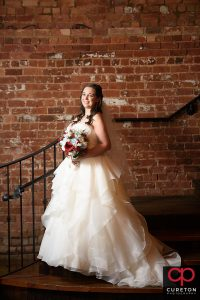 Bride holding her flowers on the Old Cigar Warehouse staircase.