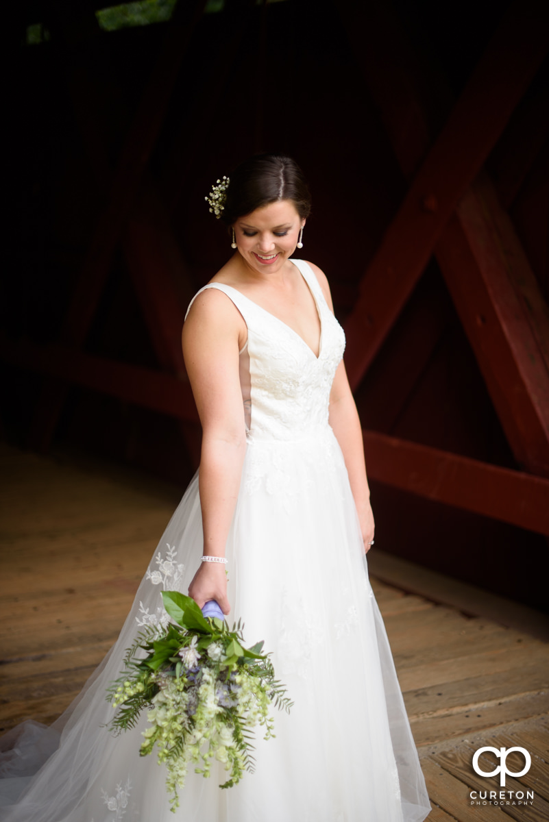 Bride holding her bouquet at Greer bridal session.