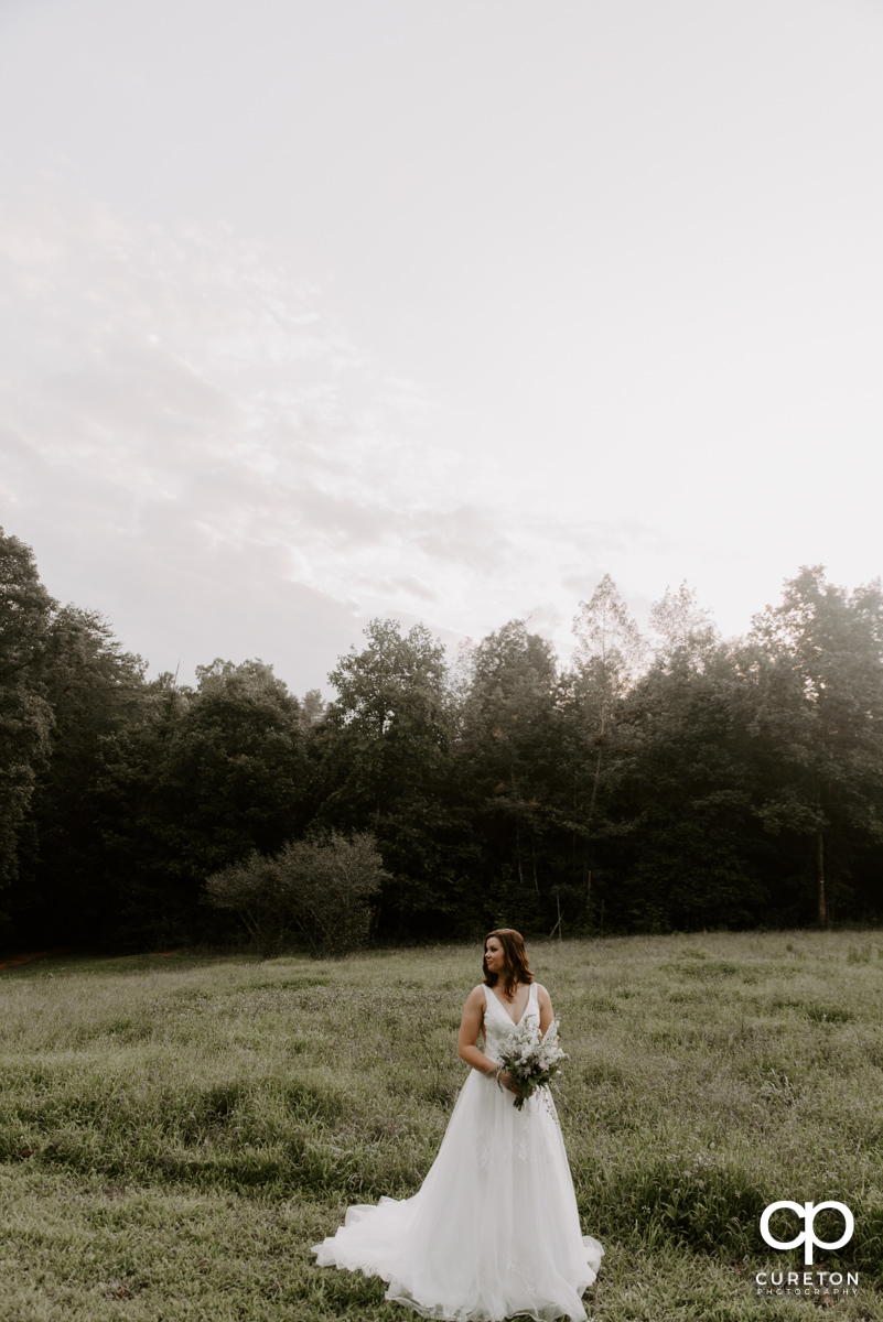 Bride letting her hair down at her rustic bridal session in Greer,SC.