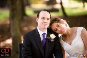 Bride and Groom in a park after their wedding in Charlotte,NC.