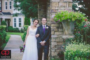 Bride and Groom in a garden after their Charlotte,NC wedding.