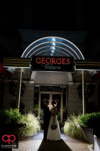 Bride and Groom outside their wedding reception at George's Brasserie in Charlotte,NC.