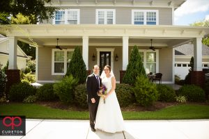 Married couple in front of their home.