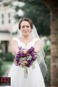Beautiful bride with her flowers after her wedding in Charlotte.