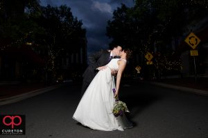 Bride and groom walking in the streets of downtown Charlotte NC.