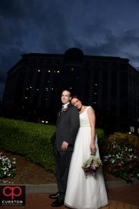 Bride and groom at sunset in the city.