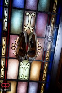 Brides shoes in a stained glass window.