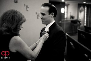 Groom getting a boutonniere .
