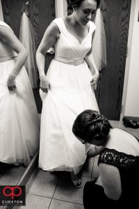 Bride putting on her shoes.