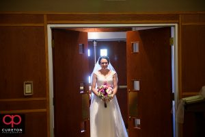 Bride making her entrance into her wedding at St. Matthew Catholic church in Charlotte NC.