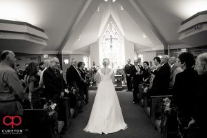 Bride walking down the aisle at her wedding at St. Matthew Catholic church in Charlotte NC.