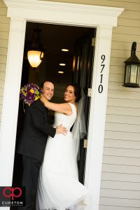 Bride and groom at their house.