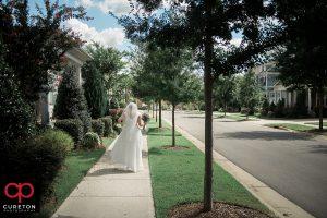 Bride walking down the street.