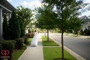 Bride walking down the sidewalk.
