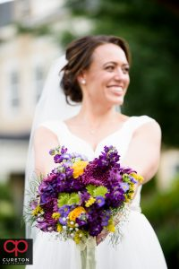 Bride and a beautiful yellow and purple bouquet.