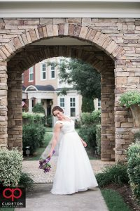 Bride standing in an archway.