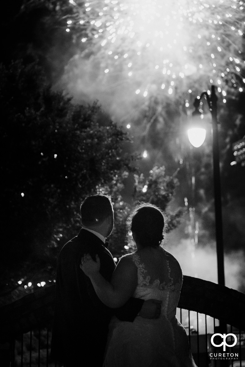 Bride and groom watching fireworks.