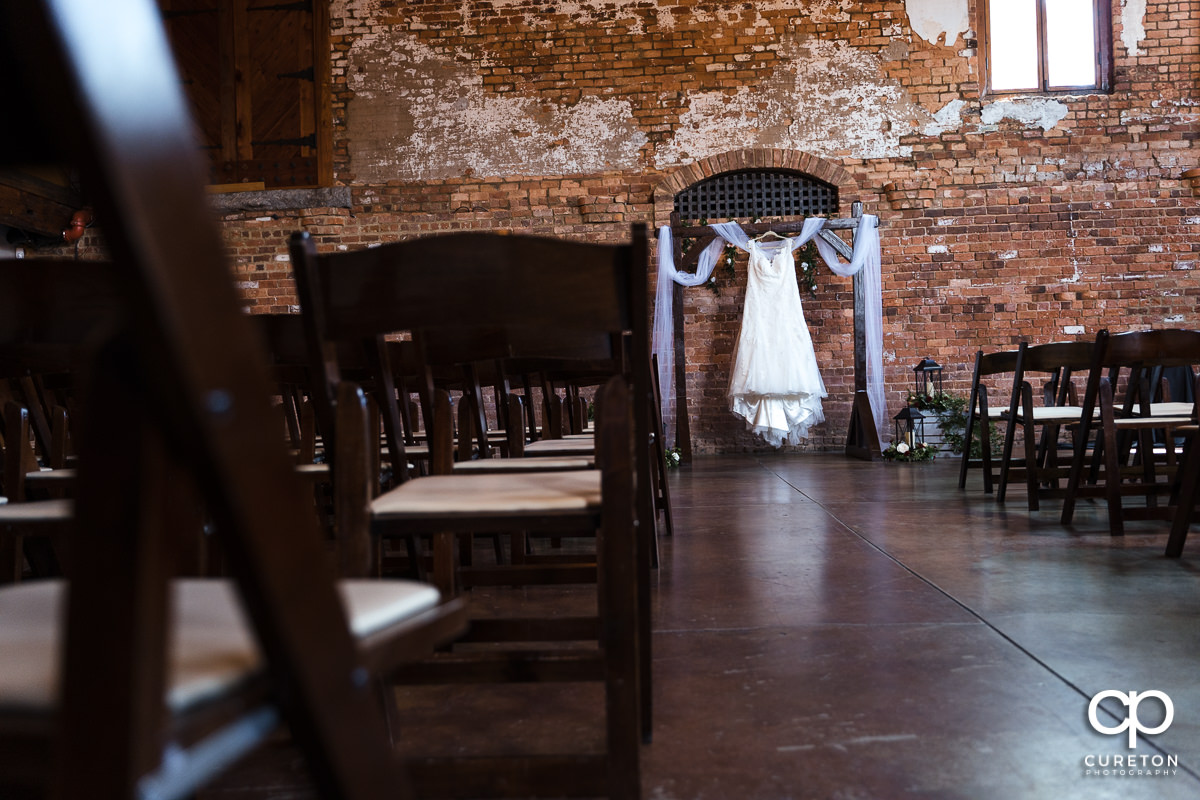 Bride's dress hanging in the mail hall of The Old Cigar Warehouse.