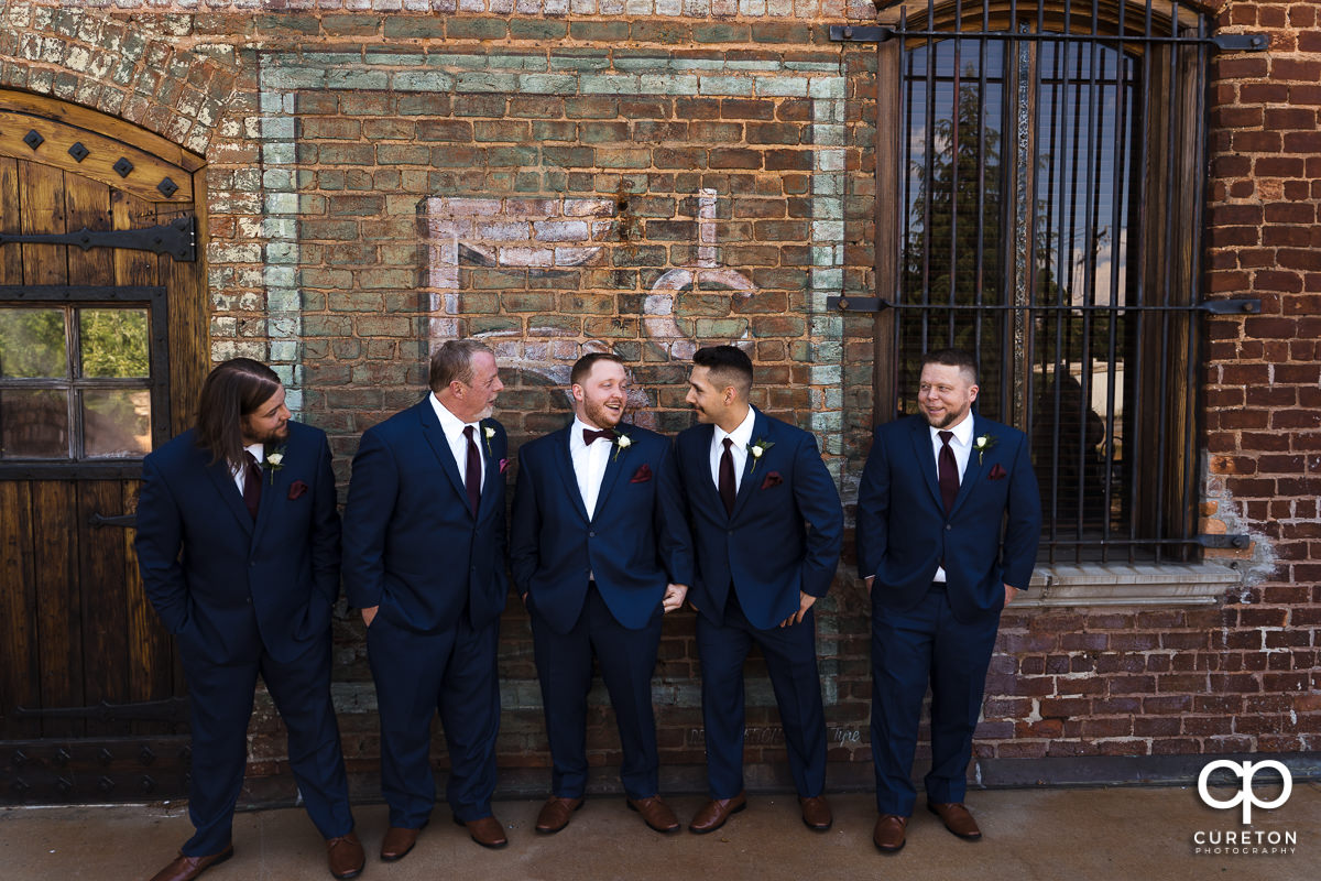 Groom and groomsmen hanging out at The Old Cigar Warehouse in downtown Greenville before the wedding ceremony.