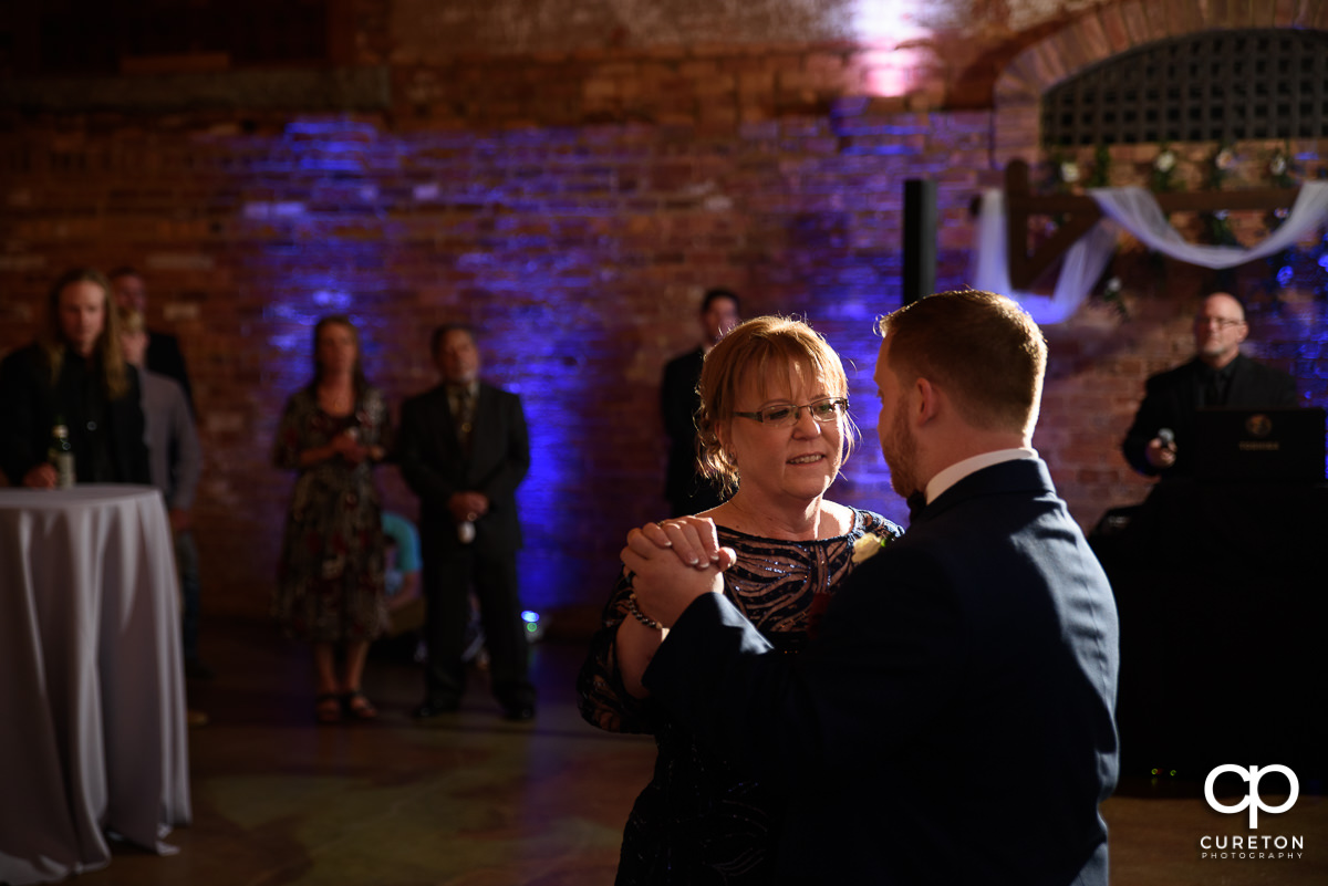 Mother of the groom and her son dancing.