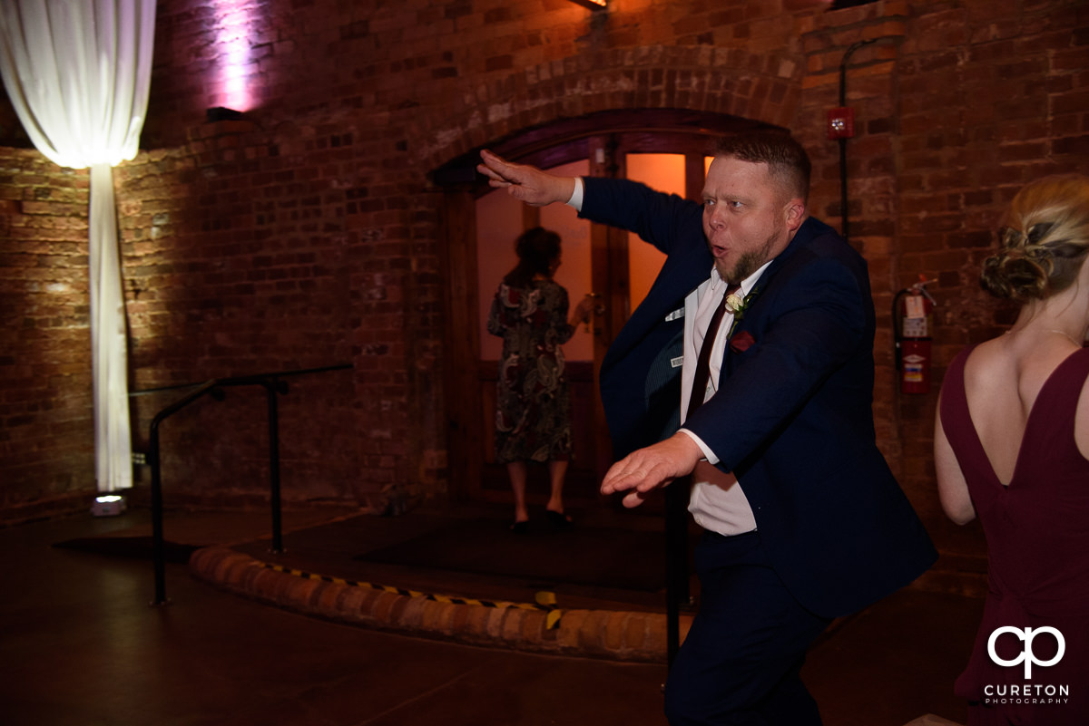 Guests dancing at The Old Cigar Warehouse to the sounds of Greenville wedding DJ Jumping Jukebox.