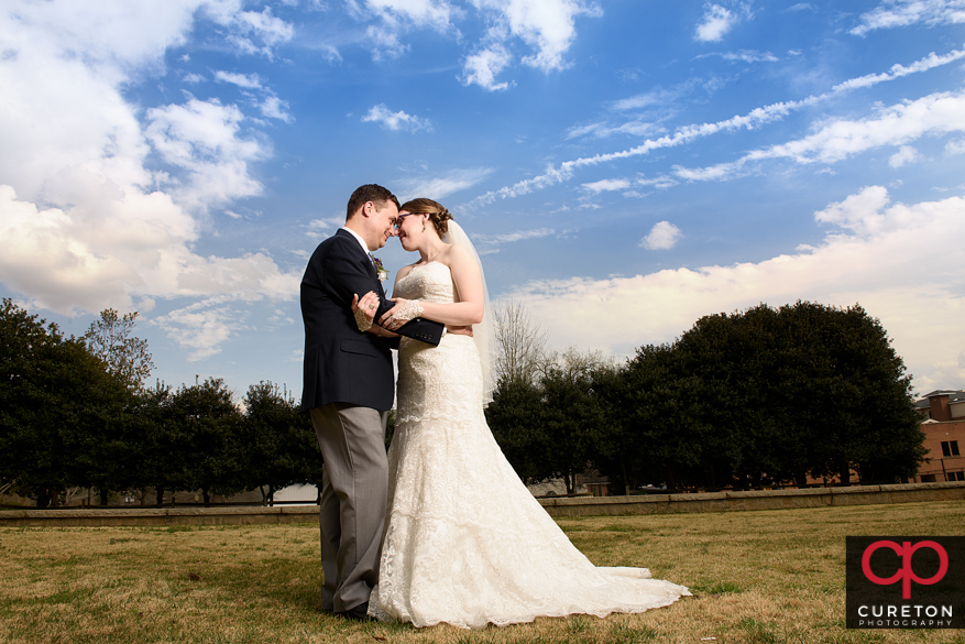 Bride and Groom with gorgeous sky after their Clemson,SC wedding.
