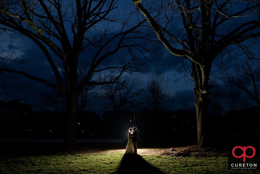 Backlit cretive shot of bride and groom in Clemson,SC.
