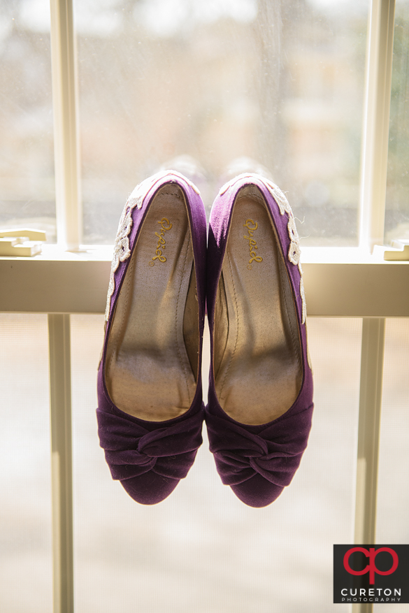 Bride's shoes in a window.