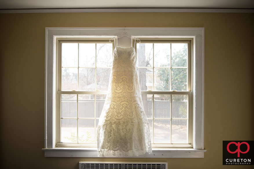 Bride's dress in a window.