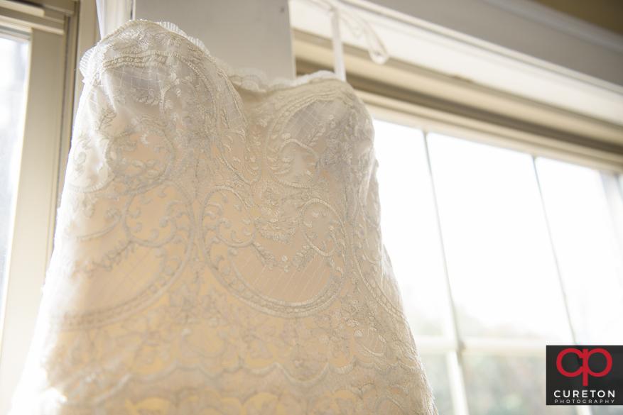 Clsoeup of brides dress.
