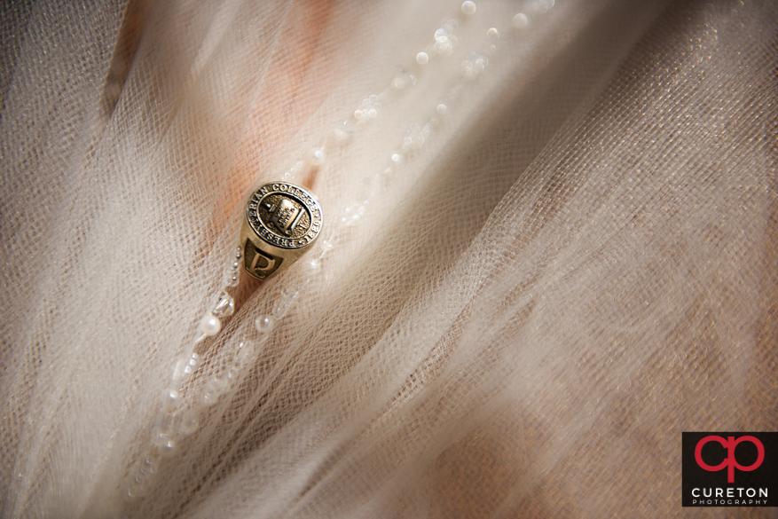 Bride's college ring.