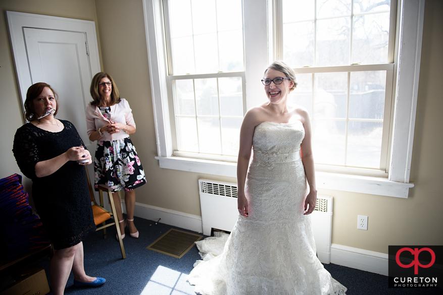 Bride in window light getting ready.