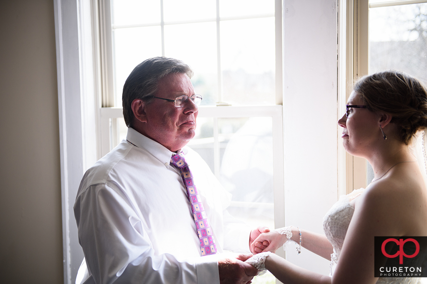 Bride's father tearing up when he first sees his daughter.