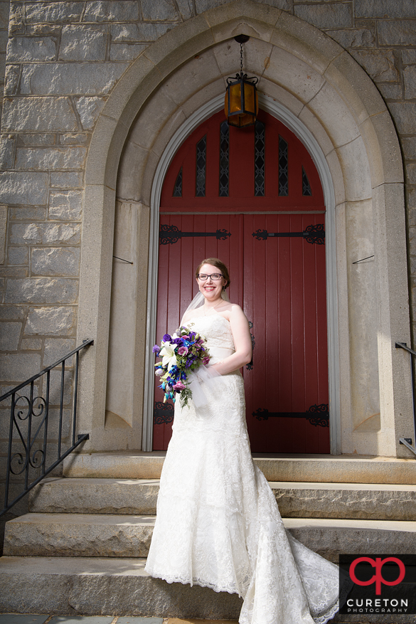 Bride in front of the church.