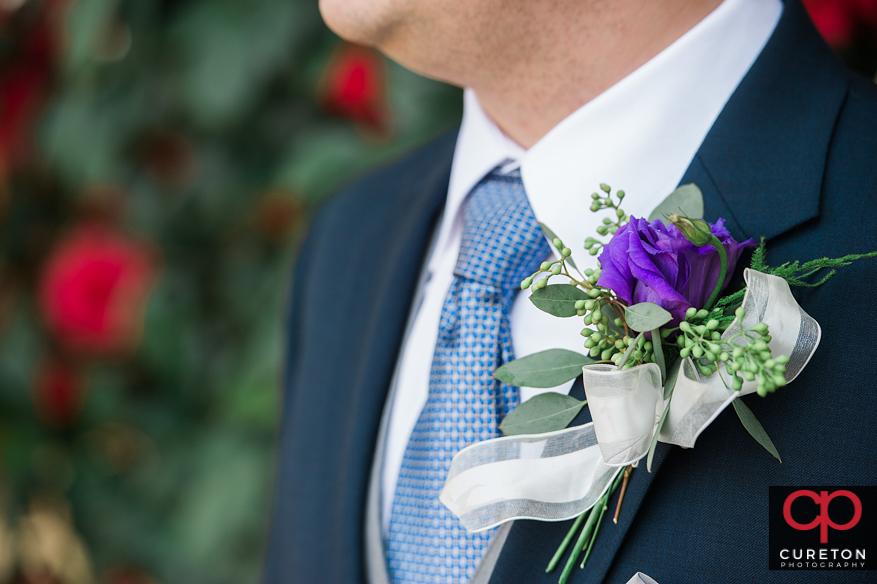Closeup of grooms flowers.