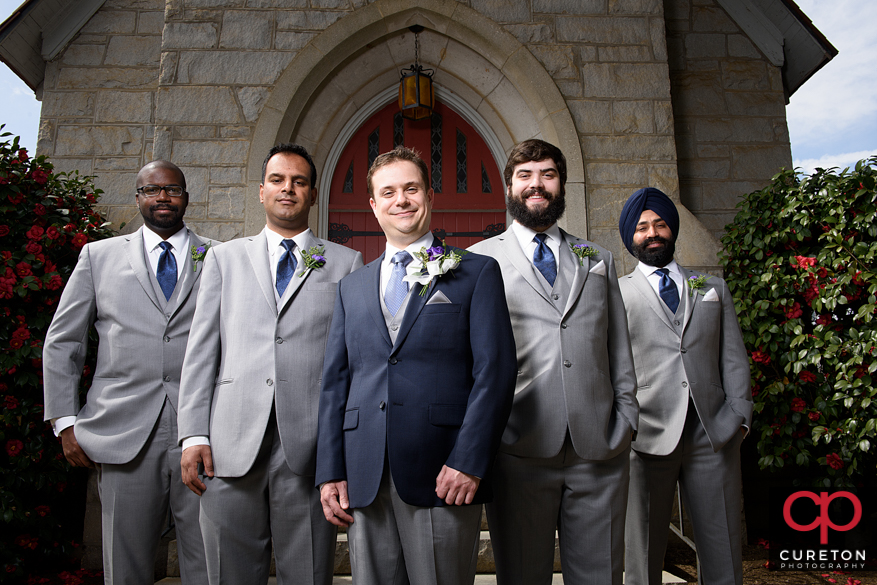 Groom and groomsmen outside of the church.