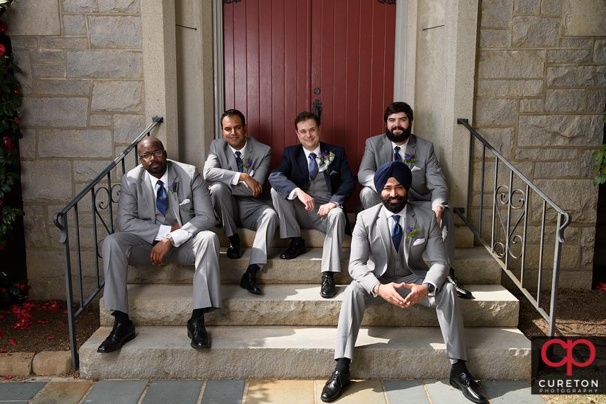 Groomsmen sitting on the steps.
