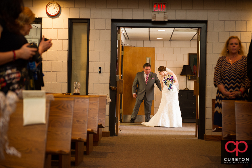 Bride and father walking down the aisle of St. Andrews Church in Clemson,SC.