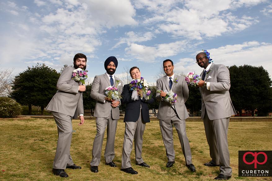 Groomsmen holding the flowers.