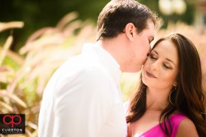 Groom kissing his bride to be during a Clemson University engagement session.
