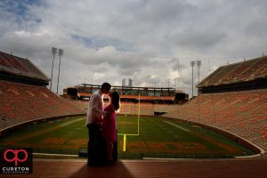 Bride and groom kissing over Howard's rock in Death Valley during a Clemson engagement session.