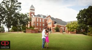 Engaged couple on Bowman field during their Clemson University engagement session.