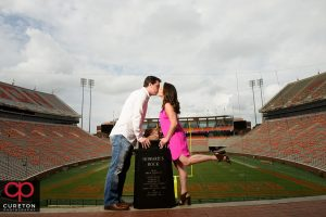 Clemson themed engagement session in the stadium with Howard;s rock.