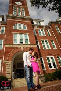 Couple kissing in front of Tillman Hall during a Clemson University Engagement Session.
