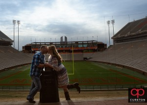 Couple kissing at Howard's rock during a Clemson stadium engagement session.