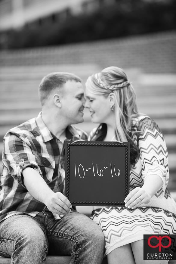 Engaged couple during a session on the Clemson University campus.